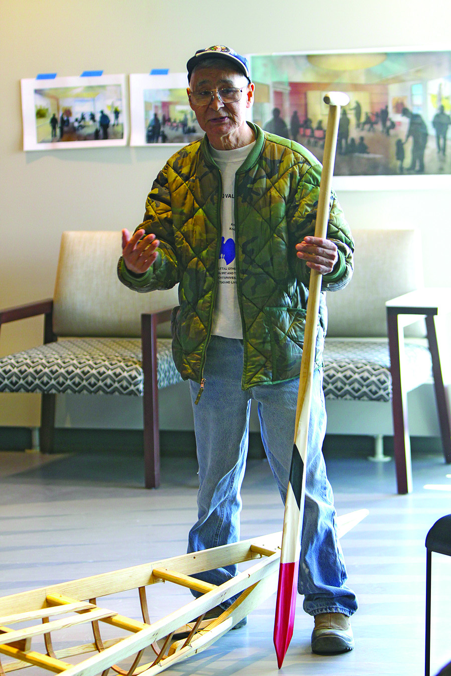 Vince Pikonganna of Nome/King Island talks about the King Island style paddle he holds in his hand.