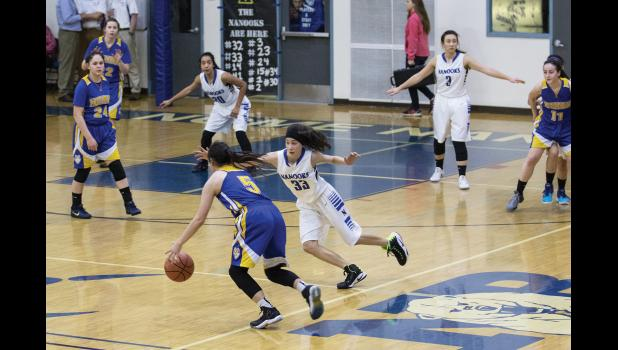 WEST COAST RIVALRY— The Kotzebue Huskies All-Tournament standout Ashley Ramoth, 5, drives past Nome-Beltz Nanooks All-Tournament player Lisa Okbaok, 33, during in the Championship Game of the 2017 Subway Showdown on Saturday evening in the Nome-Beltz gym. Kotzebue won the contest 50-38 to claim first place at the three-day event.