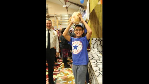 WINNER— Daniel Buffas got lucky at Nome Firemen's Carnival, bringing home a ham for dinner.