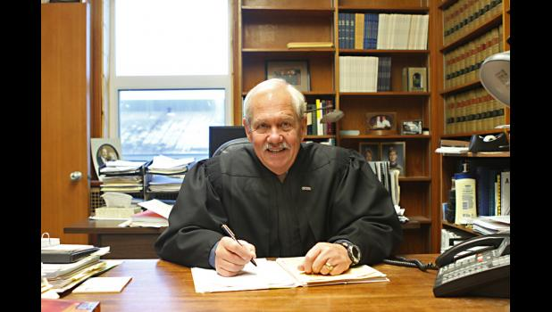 Superior Court Judge Ben Esch at his desk in Nome shortly before retiring in January 2013.