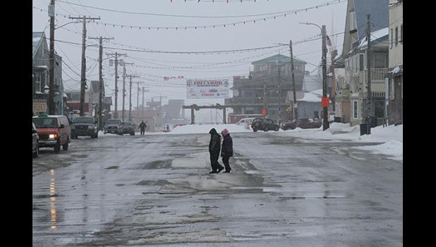 """Nome's Front Street is nearly empty, on Friday afternoon, when in """"normal"""" years many visitors stroll down Front Street."""