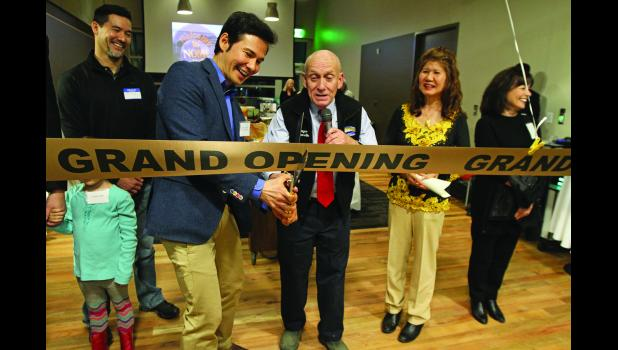 RIBBON CUTTING— Rep. Neal Foster, left, and Nome Mayor Richard Beneville, right, cut the ribbon at the grand opening ceremony of the Richard Foster Building on Friday, Oct. 28. Looking on are Jimmy Foster, left, Hoa-Nih Foster, right, and Iris Magnell.