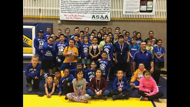 The Nome Beltz MS and HS wrestling team poses proudly with Coach Cross and Coach McGuffey after the 2018 Kotzebue  Bush Brawl. Nome was well represented at the Kotzebue Bush Brawl with a total of 52 wrestler.  Go Nanooks! Photo courtesy Julie Fabignon-Cross.