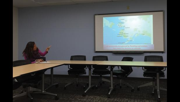 EROSION AFFECTING ALASKA VILLAGES— On Friday, May 19 at the UAA Institute of Social and Economic Research in Anchorage, Robin Bronen, Executive Director of the Alaska Institute for Justice and Senior Research Scientist at UAF Institute of Arctic Biology, points out 15 villages throughout Alaska that are imminently threatened by erosion due to climate change.