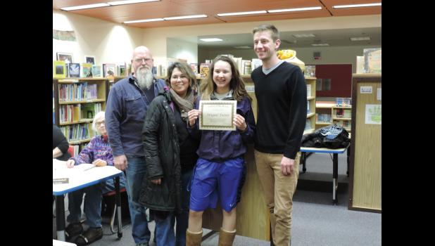 STUDENT OF THE MONTH— Abigail Tozier is Nome-Beltz Senior High's Student of the Month. She is pictured with her parents and Assistant Principal Lucas Frost.