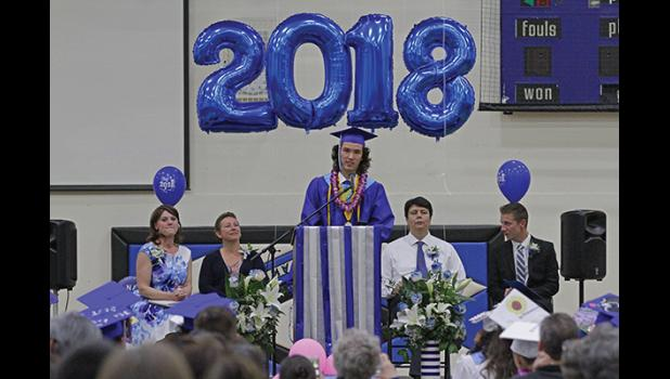 GRADUATION— Harrison Moore, Class of 2018 Valedictorian, addresses his classmates and the audience at  commencement at the Nome-Beltz High School gym on May 24.