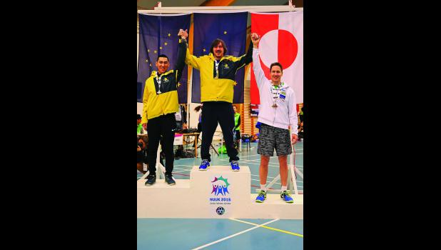 ON THE PODIUM— Unalakleet's Nick Hanson, center, and Makiyan Ivanoff, left, placed first and third in the Arctic sports event of the Two-Foot High Kick in the Arctic Winter Games held in Nuuk last week.