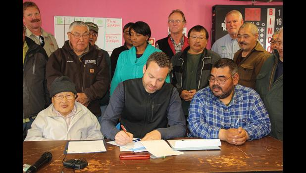 THIS LAND IS OUR LAND— Bureau of Land Management Director Neil Kornze signs a patent transferring over one million acres of land to the corporations Kukulget, Inc. of Savoonga, and the Sivuqaq, Inc. of Gambell, during a ceremony with community leaders of St. Lawrence Island on July 27.
