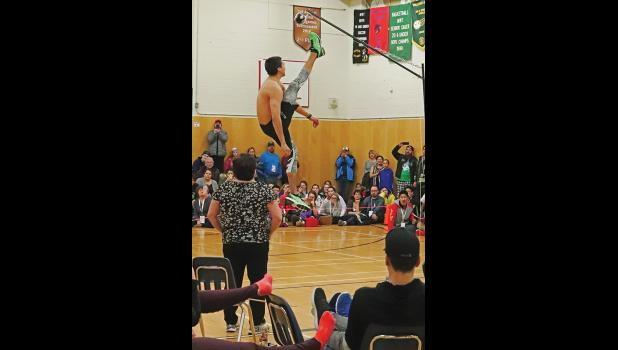 RECORD— Stuart Towarak breaks one-foot high kick record at Arctic Winter Games.