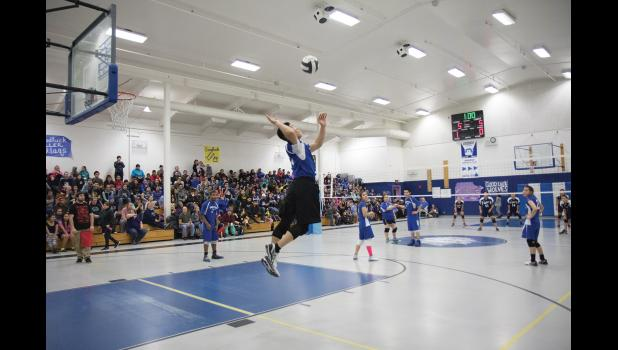 RUNNING THE GAUNTLET— Wallace Ungwiluk of the Gambell Qughsatkut serves the ball against the White Mountain Wolves on Saturday afternoon during the Western Conference Mixed-Six Volleyball Championships in Gambell. The Qughsatkut beat three traditional BSSD powerhouses to claim its first championship