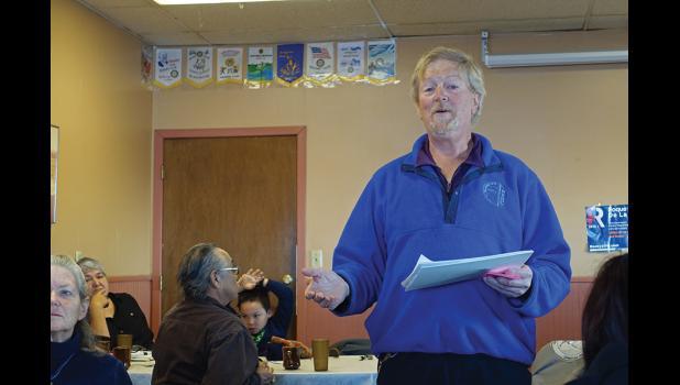 DEMOCRATIC CAUCUS—Lew Tobin reads instructions at Nome's Democratic Caucus on Saturday.