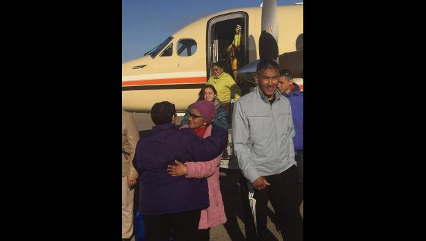 REUNION–A group of people from Chukotka landed in Savoonga for a weeks-long visit with relatives on St. Lawrence Island. The 32 Russians will return home on July 12.