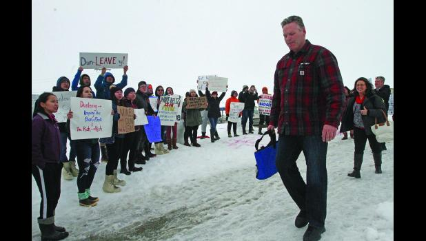 Governor Dunleavy walks past Nome-Beltz students protesting his proposed budget cuts to education. Dunleavy did not acknowledge the students as he exited Old St. Joe's after the AFP-sponsored roadshow.