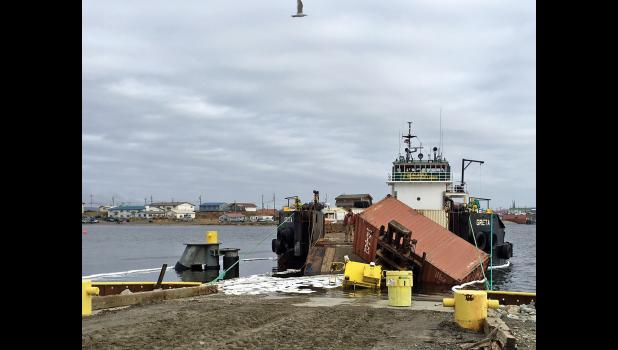 SLIPPED—Cargo loading equipment went off track when the barge Greta's ramp slipped out of position, also throwing down the container. The accident occurred mid-morning Sunday.