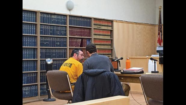 DAY OF RECKONING—Amos Oxereok talks with his attorney James Ferguson at his sentence hearing Feb. 28 in Nome. Oxereok received jail time in a sexual assault case involving 13 school girls in Wales.