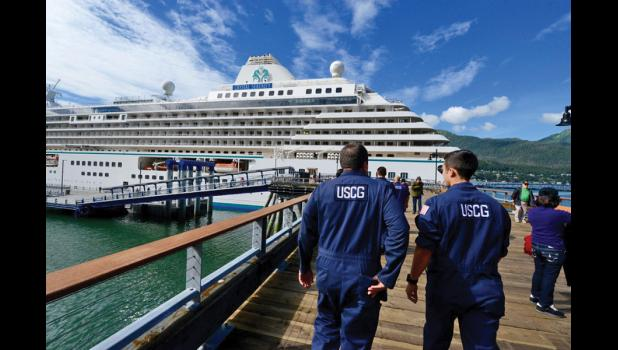 INSPECTING— Members of Coast Guard Sector Juneau inspections division arrive at the cruise ship Crystal Serenity moored in Juneau, Alaska, to conduct a certificate of compliance exam June 22, 2016. The exam tests the crew's ability to react in the case of an emergency covering a range of different scenarios.