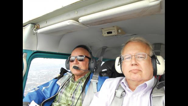 GOODWILL FLIGHT— Dan Billman, left, and Marshall Severson fly over Russia in the cockpit of a Cessna 172.