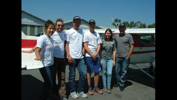FLIGHT SCHOOL - Students from Nome-Beltz High School traveled to California this summer for a three week flight school course at CP Aviation in Santa Paula. Pictured from left to right are Nome-Beltz student Ivory Okleasik, Nome-Beltz teacher Dave Padvorac, Nome students Bubba McDaniel & Aaron Motis and CP Aviation Flight Instructors Aravni Katchikians and John Gentzle.
