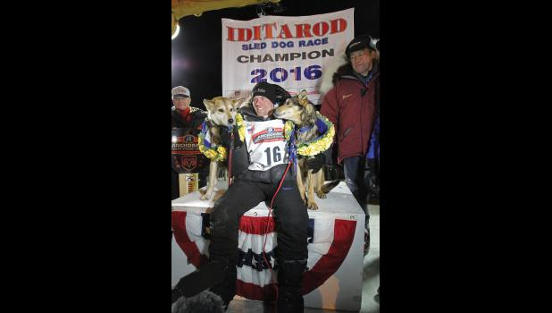 CHAMPIONS— Four-time winner Dallas Seavey and his leaders Reef and Tide once again claimed victory in the 1,000-mile long Last Great Race in record time.