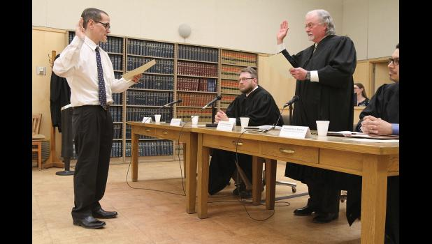 INSTALLATION— Alaska Supreme Court Justice Craig Stowers administers the oath of office to Nome Superior Court Judge Romano DiBenedetto as Fairbanks Judge Matthew Christian and Second Judicial District Presiding Judge Paul Roetman look on, on Thursday, April 13 in the Nome Courthouse.