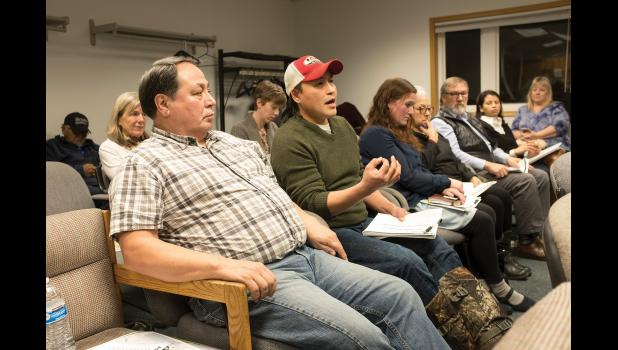 ROAD TO AMBLER— The Northwest Arctic Borough's John Chase, in hat, makes a point at the Ambler Road scoping meeting Wednesday, Dec. 6 in Kotzebue. In foreground is Hiram Walker. The federal Bureau of Land Management is holding scoping meetings for an EIS in the region.