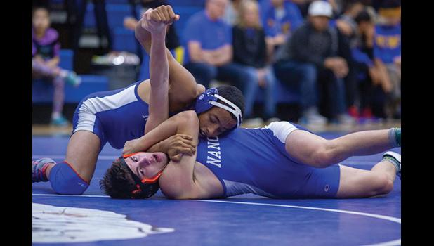 TECHNICAL  MOVE – Nanook Ben Cross, top, downed team mate Tobin Hobbs in the championship match by a fall.