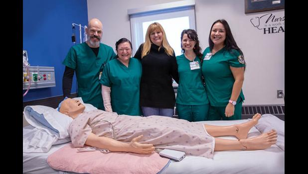 FUTURE NURSES – The current cohort of nurses-to-be and their instructor get their picture taken with their favorite patient. From left are Daniel Hobbs, Veronica Verbridge, RN and instructor Wendy Smith, Vanessa Tahlhofer and Kallie King.