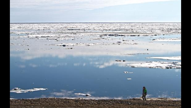 EARLY BREAKUP— An unsually warm spring caused early breakup. Norton Sound shows open water and decaying sea ice in front of Nome.