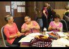 MKRomberg, Caroline Muktoyuk-Brown and Loretta Bullard share a laugh at the crocheting table at the Fiber Fest.