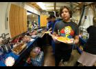 SERVING IT UP – Eighth grader Daniel Brandt works in the concession both Friday night. Proceeds go to the Washington D.C. trip the eighth graders will take this spring.